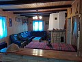 Chata Zuzanka - obývacia izba s krbom